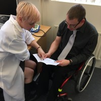 Doctor and patient reading a leaflet