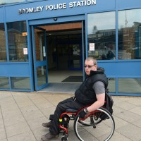 A wheelchair-using man outside Bromley Police Station