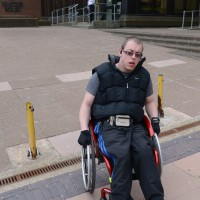 Man in a wheelchair outside the Job Centre