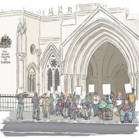 A group of protestors with placards outside the Royal Courts of Justice
