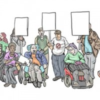 A group of people, including people using mobility devices, holding placards